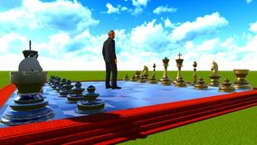 Businessman on chess board Royalty Free Stock Photography