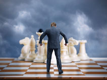 Businessman on the chess board Royalty Free Stock Photos