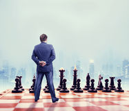 Businessman on the chess board Stock Images