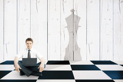 Businessman with chess king shadow Royalty Free Stock Photos