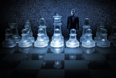 Businessman on a chessboard as a dummy Stock Image