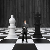 Businessman on chessboard Stock Images