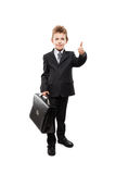 Businessman child boy holding briefcase gesturing thumb up success sign Stock Image