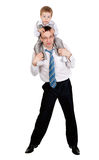 Businessman with a child on his shoulders. In the studio, isolate on white Stock Photo
