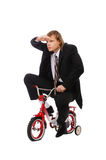 Businessman on childish bycicle Royalty Free Stock Photography