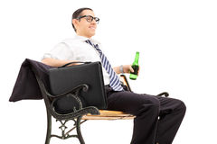 Businessman chilling out with a beer Royalty Free Stock Photos