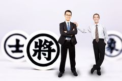 Businessman with chinese chess stock photography