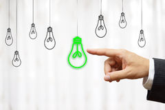 Businessman choose green light bulb, idea & environment concept Stock Images