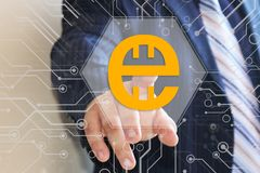 Businessman chooses Estcoin on the touch screen. Business technology coin concept royalty free stock images