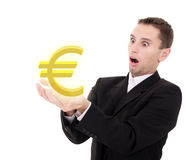 Businessman chooses golden euro sign. On a white background stock image