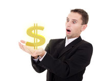 Businessman chooses golden US dollar sign. On a white background stock photos