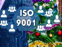 The businessman chooses ISO 9001 on the touch screen, the backdr. Op of the Christmas tree and decorations. Special toning Stock Photography