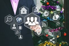 The businessman chooses the network Interface online user. On the touch screen, the backdrop of the Christmas tree and decorations. Special toning Stock Images