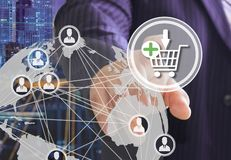 The businessman chooses on the shopping cart on the touch screen with a futuristic background.The concept of online . Auctions. stock illustration