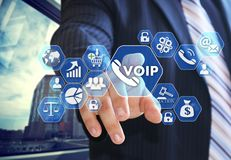 The businessman chooses VOIP on the virtual screen in social net. Work connection Royalty Free Stock Photos