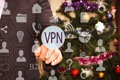The businessman chooses a VPN on the touch screen, the backdrop. Of the Christmas tree and decorations Royalty Free Stock Photography