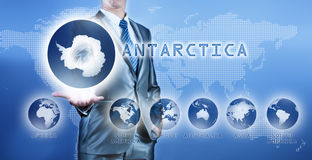 Businessman choosing antarctica continent Royalty Free Stock Images
