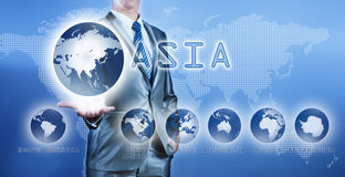 Businessman choosing asia continent on virtual digital screen Stock Photography