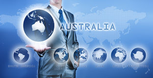 Businessman choosing australia continent. On virtual digital screen, business concept of decision making stock photos