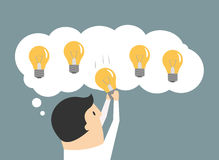Businessman choosing the best idea light bulb Royalty Free Stock Image