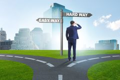 The businessman choosing between hard and easy way. Businessman choosing between hard and easy way royalty free stock photo