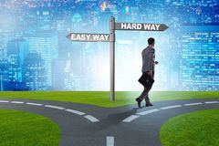 Businessman choosing between hard and easy way. The businessman choosing between hard and easy way stock images
