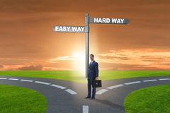 The businessman choosing between hard and easy way. Businessman choosing between hard and easy way royalty free stock image