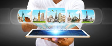 Businessman choosing his holidays between different places of th Royalty Free Stock Photo