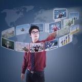 Businessman choosing his partner on modern interface Royalty Free Stock Photos