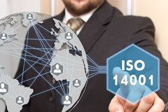 The businessman is choosing ISO  14001. On the touch map of the world Stock Photo
