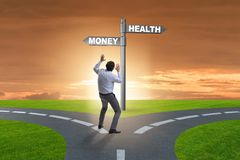 The businessman choosing between money and health. Businessman choosing between money and health stock photography