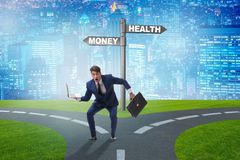 The businessman choosing between money and health. Businessman choosing between money and health stock photo