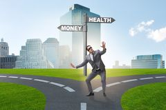The businessman choosing between money and health. Businessman choosing between money and health royalty free stock photo