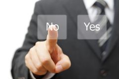 Businessman choosing no instead yes button Royalty Free Stock Image