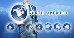 Businessman choosing north america continent. On virtual digital screen, business concept of decision making Stock Image
