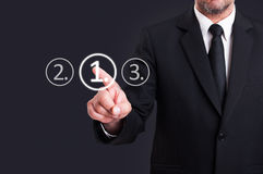 Businessman choosing number one digital button from touchscreen Royalty Free Stock Photo