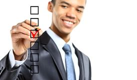 Businessman choosing one of three options Royalty Free Stock Photography