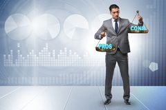 The businessman choosing pros and cons stock photo