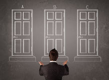 Businessman choosing the right door Royalty Free Stock Image
