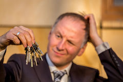 Businessman choosing the right key Royalty Free Stock Photos