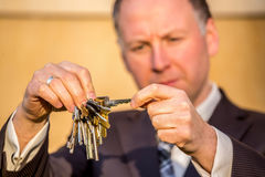 Businessman choosing the right key Royalty Free Stock Image