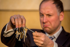 Businessman choosing the right key Stock Photos