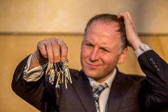 Businessman choosing the right key Royalty Free Stock Photography
