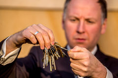 Businessman choosing the right key Royalty Free Stock Photo
