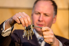 Businessman choosing the right key Stock Photography