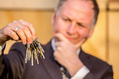 Businessman choosing the right key Stock Images
