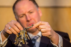 Businessman choosing the right key Stock Photo
