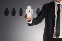 Businessman choosing right partner from many candidates.  Stock Photo