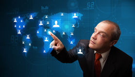 Businessman choosing from social network map Stock Photography