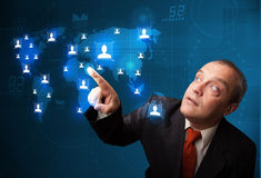 Businessman choosing from social network map Royalty Free Stock Image